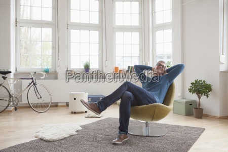 relaxed mature man at home sitting