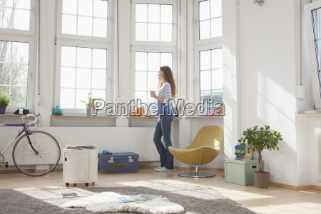 woman at home looking out of