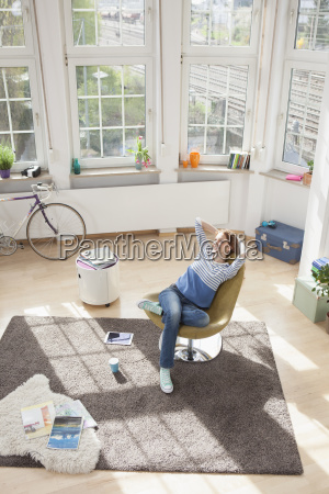 relaxed, woman, at, home, sitting, in - 18002678