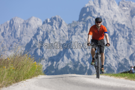 man on a bicycle tour with