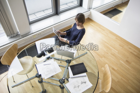 businesswoman with digital tablet and laptop