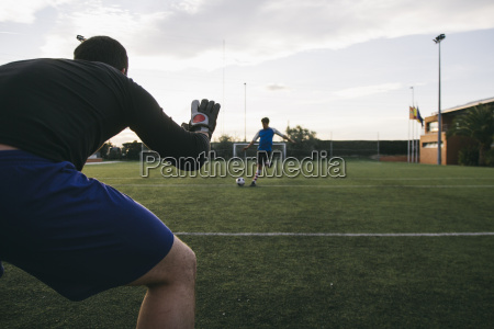 goalkeeper prepared to stop the ball
