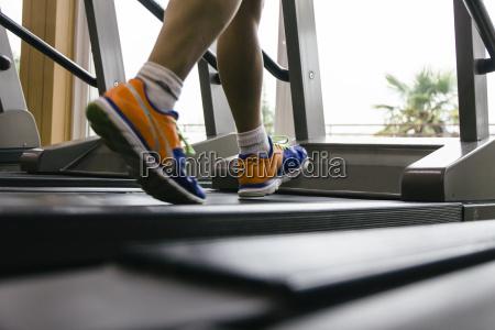 man running on a treadmill sport