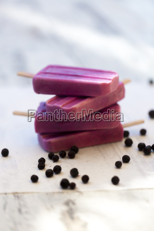 stack of homemade blueberry ice lollies