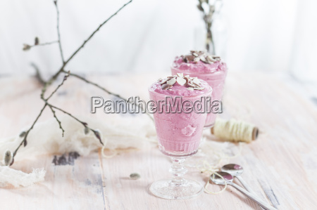 two glasses of raspberry mousse with