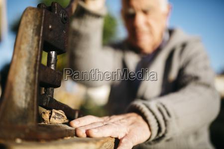 senior man using an old tool