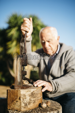 senior man using an old tool