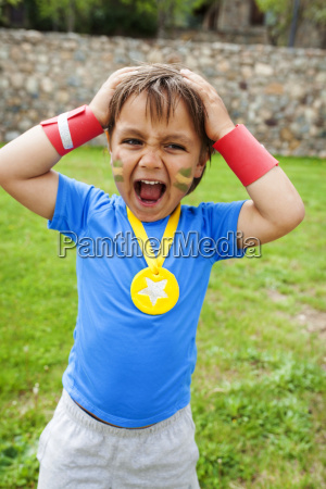 little boy with medal around his