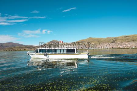 peru titicaca lake boat sailing from