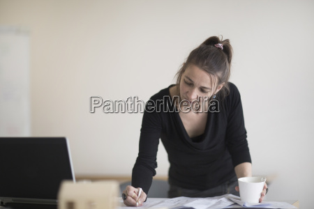 woman in office working on plan