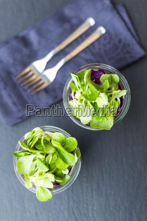 rainbow salad in glasses with chickpeas