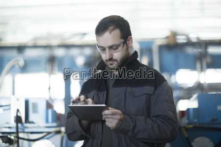 young technician working with tablet pc