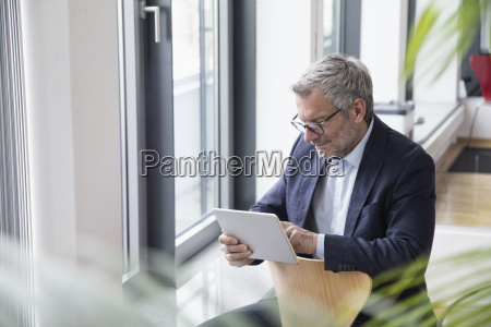successful businessman sitting in board room