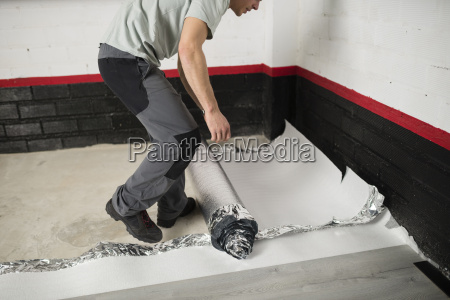 young man placing a insulating material