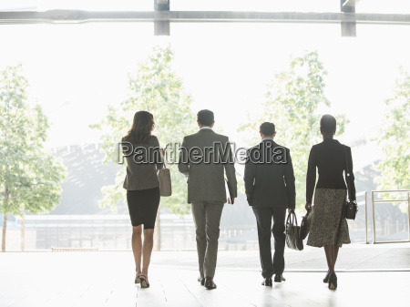 corporate business people walking in a