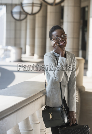 portrait smiling corporate businesswoman talking on