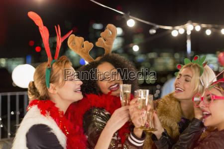 young women wearing christmas reindeer antlers
