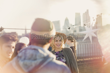 young adult woman enjoying rooftop party