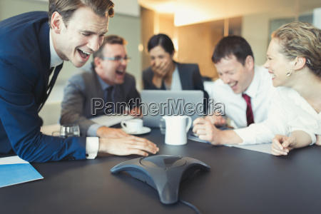 laughing business people on conference call