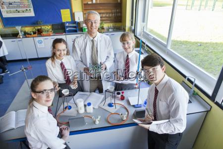 portrait confident chemistry teacher and high