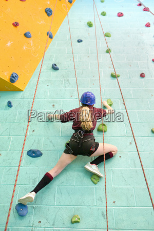 high school student climbing rock climbing