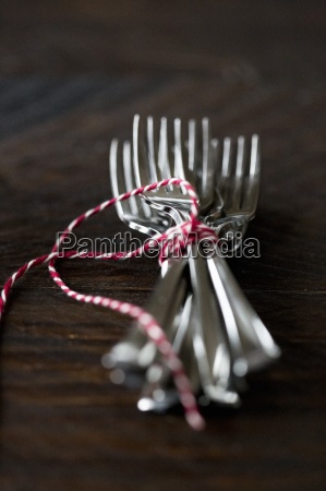forks tied with string on a
