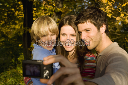 family taking self portrait outdoors in