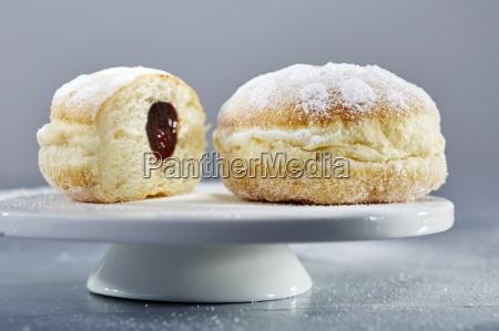 doughnuts with icing sugar and ham