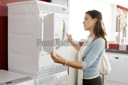 a woman looking at a washing