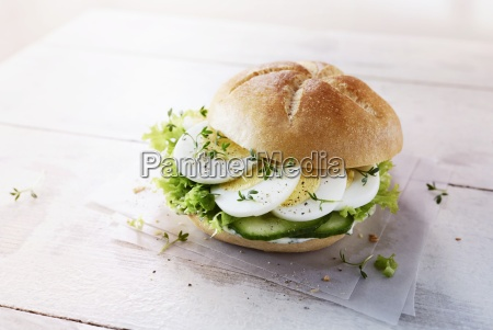 a roll with egg cucumber lettuce