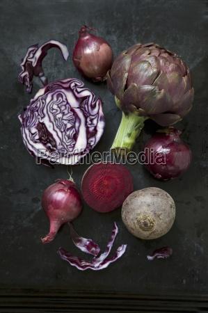 an arrangement of vegetables featuring artichokes