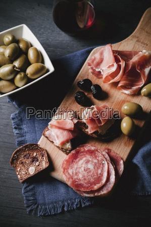 an open salami sandwich and an