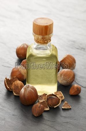 a bottle of hazelnut oil surrounded