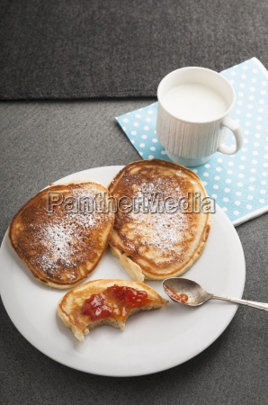 buttermilk pancakes with icing sugar and