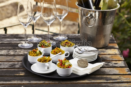 couscous salad in coffee cups on