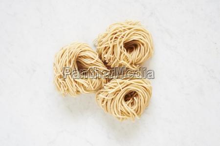 fresh pasta three pasta nests on