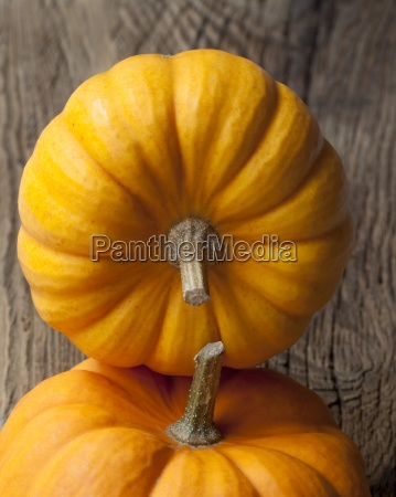 pumpkins on a wooden surface