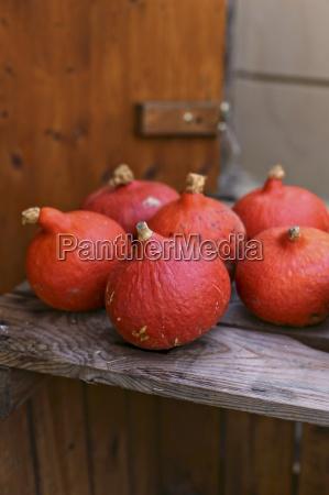 hokkaido pumpkins on a wooden surface