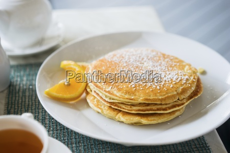 a stack of pancakes dusted with