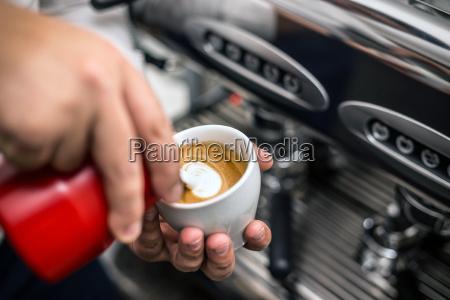 barista preparing proper cappuccino
