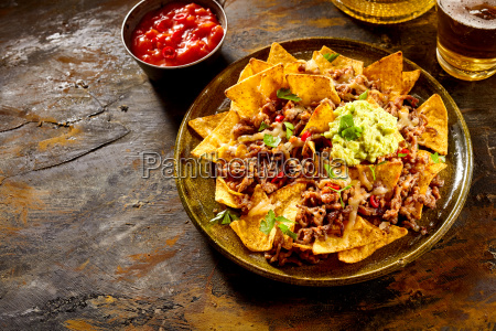 chips with cheese meat guacamole and