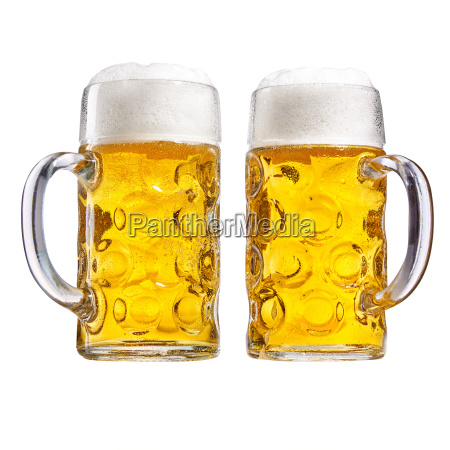 two glass tankards of chilled frothy