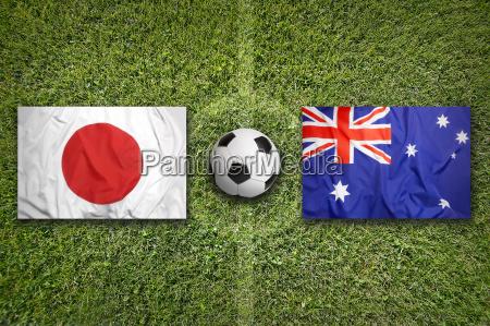 japan vs australia flags on soccer
