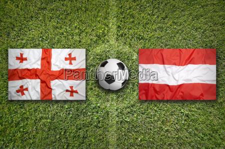 georgia vs austria flags on soccer