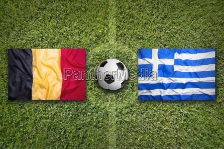 belgium vs greece flags on soccer