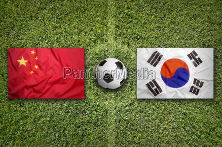 china vs south korea flags on