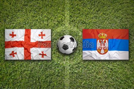 georgia vs serbia flags on soccer