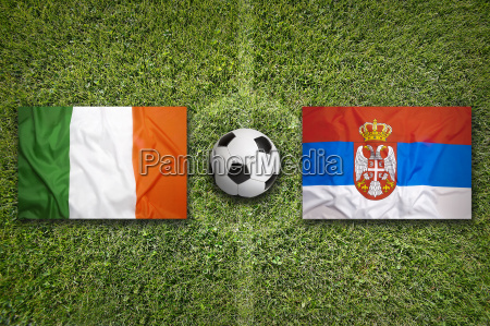 ireland vs serbia flags on soccer