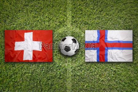 switzerland vs faeroe islands flags on