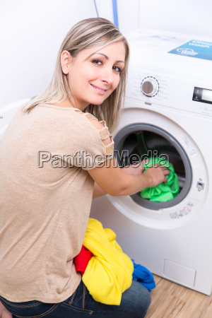 housework young woman doing laundry shallow